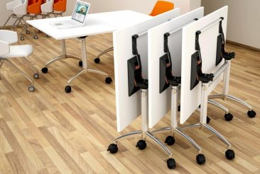 Modular flip top tables nestled together