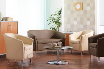 Barolo armchair and sofa finished in leather with infill panel